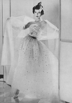 Victoire in gorgeous evening gown of layers of sparkling sequined tulle by (YSL) Dior, coiffure by Guillaume, photo by Henry Clarke, Vogue, March 1958 Vintage Dior, Christian Dior Vintage, Vintage Couture, Mode Vintage, Vintage Vogue, Vintage Glamour, Vintage Ladies, Fifties Fashion, 50 Fashion
