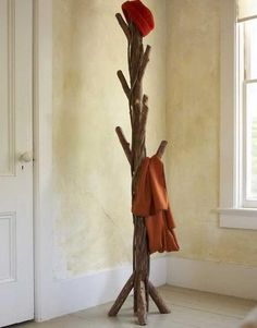 Home Decor, Diy Tree Coat Rack Storage Organization Freestanding Coat Rack With The Smart And Unique Design Ideas That Look So Elegant And Amazing With Red Hat On The Top That Look So Unique And Elegant ~ Some Interesting Designs Of Freestanding Coat Rack To Make Your Room Neat And Great