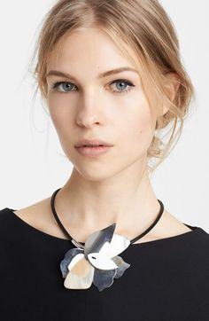 Free shipping and returns on Marni Flower Pendant Necklace at Nordstrom.com. An abstracted flower crafted from earthtone slabs of bone add architectural interest to a collar-gracing cord necklace.