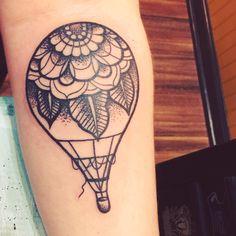 Hot air balloon tattoo Flower tattoo Black ink tattoo