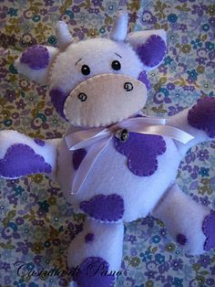 white and purple cow