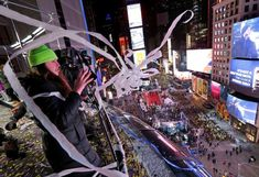 Crystal ball drops in frigid Times Square to mark 2018 - January 1, 2017.  People throw streamers from the Marriott Marquis during New Year's celebrations in Times Square, New York, Sunday, Dec. 31, 2017. New Yorkers, celebrity entertainers and tourists from around the world are packing into a frigid Times Square Sunday to mark the start of 2018 with a glittering crystal ball drop, a burst of more than a ton of confetti and midnight fireworks. (AP Photo/Seth Wenig)