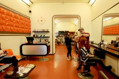 This 70's looking interior from Haareszeiten, a hair salon in Berlin, Germany.   Using traditional interior trend colours from the 1970s: orange and brown  @salonboost #salonideas #saloninteriors #berlin #hairsalons