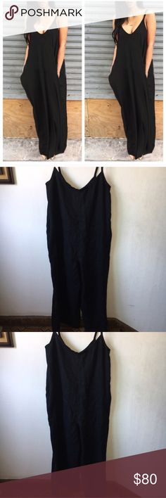 Black Linen Oversized Jumper Jumpsuit Size 14 Black Linen Jumpsuit Size 14, spaghetti straps, back Zipper. I purchased this at Nordstrom during their yearly sale. There is no tag or Size. But the price tag states 14. True to size. Side pockets. Oversized fit. Brand new with tags Nordstrom Pants Jumpsuits & Rompers