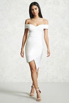 A knit dress featuring an off-the-shoulder sweetheart neckline, short sleeves, an asymmetrical tulip hem, side ruching, and a bodycon silhouette.