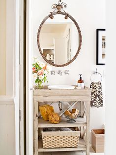 Love the weathered wood vanity. It is fun to pack a lot of personality into a tiny powder room!