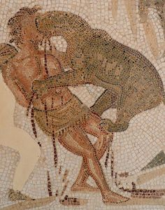 Roman Mosaic. Coliseum. El Djem, Tunisia. Condemned criminal being devoured by wild beast.