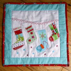 Christmas Stockings mini quilt by Sarah @ FairyFace Designs, via Flickr
