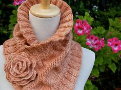 Gorgeous scarf/cowl. Love the flower! Order the pattern here.