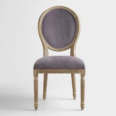 Boasting a curved, shapely silhouette, our velvet round-back side chairs are a nod to traditional charm. Crafted of white American oak, they feature a distressed finish that adds to their classic appeal.
