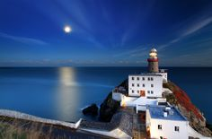 Moonrise over a lighthouse -- love the color here.