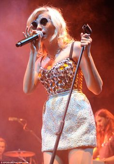 Jewelled lady: Pixie Lott performs at V Festival wearing a gem-covered leotard and a pretty mini skirt Festival Looks, Festival Wear, Simplicity Fashion, Leotards, Fashion Forward, Pixie, Crowd, Mini Skirts, Legs