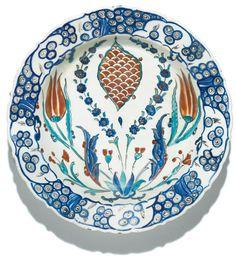 An Iznik polychrome pottery dish with a scale-designmedallion, Turkey, circa 1575