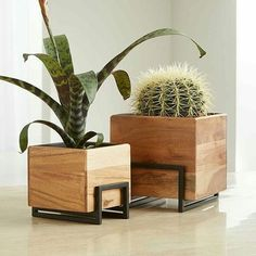 Sale ends soon. Designed by Kristine Morich and handmade by skilled artisans, richly grained acacia wood planters nest in black powdercoated iron stands. Rustic Planters, Wooden Planters, Indoor Planters, Diy Planters, Planter Boxes, Flower Planters, Succulent Planters, Concrete Planters, Ceramic Planters