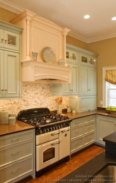 #Kitchen of the Week: Light and creamy blue-green cabinets by Crown Point with a beige wood hood and vintage stove (Crown-Point.com, Kitchen-Design-Ideas.org)