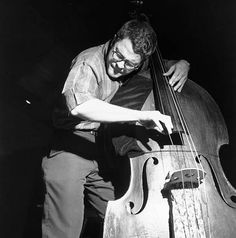 A portrait of Charlie Haden as he plays the bass during the recording session for Ornette Coleman's Empty Foxhole album.