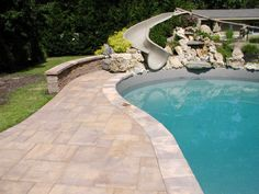 Make your backyard a hit with the kids. Add a water slide going into your pool!