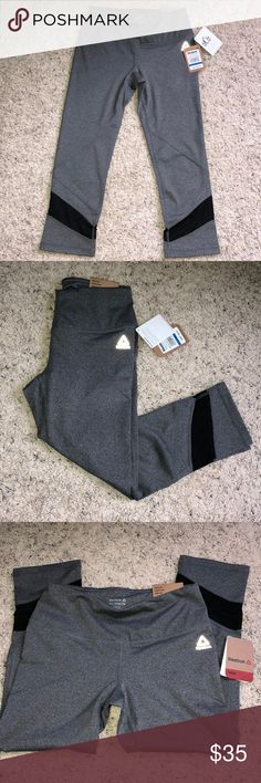 Reebok NWT!!!! Beautiful charcoal and heather black designed XS Reebok Leggings. Crop design. NWT. Have black mesh along the calf!!  Very breathable and great for crossfit or yoga etc ! Please bundle to save and I am open to offers:) Reebok Pants