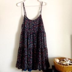 """Baby doll Dress Colors are dark teal with flowers. Straps are adjustable. Have a lining. 55% cotton and 45% polyester. Flowy. Measurement laying flat: bust: 19.5"""" Length: 34"""" Worn twice - no stains or holes. Umgee Dresses Midi"""