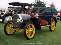 1904 - National Model C Touring car....unusual engine compartment....