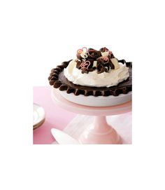 This pie is almost too beautiful to eat! Chocolate crust with mocha latte filling and whipped cream, candy hearts and chocolate curls make for a treat full of different textures. Get the recipe.   - WomansDay.com
