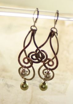 Long swirls copper and brass earrings with wave by IngoDesign, $26.00