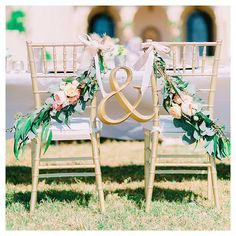 Sit in style with ridiculously gorgeous bride and groom chairs draped in flowers. How enchanting! Xoxo @weddingchicks PC: @catherine_ann_photography #chairs #flowers #wedding #signs #love