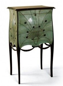 Paul-Iribe-Commode - A delightful commode, laquered in celadon green,  is a pared down version of an intimate piece of furniture conceived during the reign of Louix XV and his mistress. Its stylized sunburst motif is one of Art Deco's most favoured.