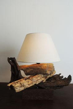 This #lamp is made in Italy with #driftwood from Tyrrhenian Sea (Italy) and with a antique iron base.