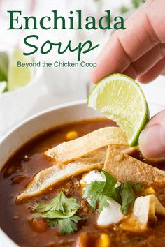Enchilada soup is full of black beans and corn with a delicious tomato and enchilada broth.  #soup #enchiadasoup #souprecipes #dinner #lunch  via @Beyondthecoop