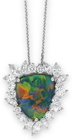 A BLACK OPAL AND DIAMOND PENDANT NECKLACE/BROOCH Suspending a pendant/brooch, set with a shield-shaped black opal, within a marquise and brilliant-cut diamond surround, to the length adjustable fine neckchain, mounted in platinum, pendant/brooch 3.4 cm long, neckchain 51.5 cm long  BestOpalRings.com