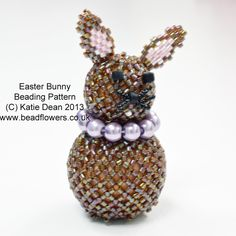 This beading tutorial shows you how to make an easter bunny. It is based on the snowman decoration from my book, 'Beaded Christmas Decorations'. Box Patterns, Jewelry Patterns, Beading Patterns, Beaded Christmas Decorations, Snowman Decorations, Beading Projects, Beading Tutorials, Beading Ideas, Easter Bunny