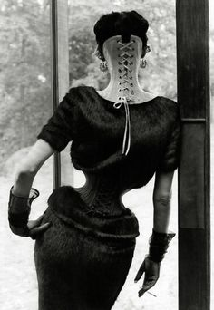 """Ethel Granger - had the smallest waist on record.  This was obtained through the """"strong"""" encouragement of her husband to """"corset train"""".  Ethel wore the corset 24 hrs a day in an attempt to shape her body to please her husband.  From there her husband moved on to piercing her for his own admiration and insisting she wear 5"""" heels daily.  He slowly enlarged piercings in her ears, septum and eventually gave her 13 piercings in total.  Ethel Granger's marriage seemed a life long struggle to…"""