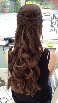 Prom hair - I did this hairstyle on my sister for her prom. It's all her own hair. The style involve creating a bump on the crown, incorporating the fringe into the style with a waterfall braid before securing the rest in a half up style. I finished it off by curling it.