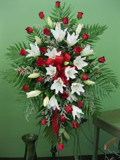 Red Roses and White lilies make a beautiful Easel Spray.