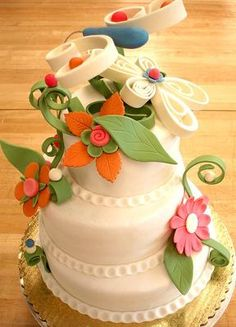 Ornate Gum Paste Cake: This beautiful cake was created by starfin from flickr (who graciously gave us permission to share this photo.)  The detail work was built out of gumpaste
