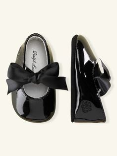 Ralph Lauren patent leather baby shoes with ribbon ties.