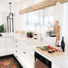 I can say from experience having a huge window over your sink is the best thing ever!  I love @michelle_janeen 's kitchen SO much!  What do you love about it?  Get featured use #imaremodelaholic by remodelaholic