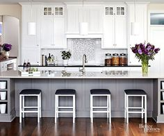 There's a lot of reasons to love the white kitchen design trend! The spacious feel from crisp white cabinets, the cozy vibe of a cream colored kitchen, and the beautiful contrast of dark countertops to white walls and ceilings are just a few of these reasons. Try classic white in your kitchen for a timeless look that won't go out of style.