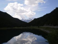 A Lake with some Cumulus in the sky Photo taken near Sondrio - in Valtellina Alps Region. Italy