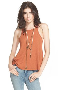 Free shipping and returns on Free People 'Long Beach' Tank at Nordstrom.com. A finely knit racerback tank is cut in a swingy boardwalk-ready silhouette.