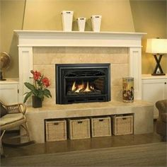 Like:  fireplace insert surrounded by tile, with white mantel and surround, ties in to white storage cabinets flanking the fireplace.  Also like the raised hearth making for a place to sit when there is a room full of people...with storage space for wood & kindling below...(though you would presumably need something a little sturdier than a lightweight wicker basket to hold logs?)