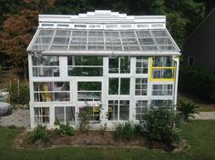 This is a Greenhouse made by me alone and is in memory of my Mother and Daughter. It is mainly made from 110 yr. old windows obtained from the Eastern ...