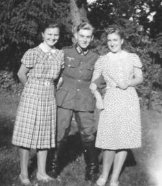 Two German girls in everyday dresses.