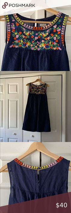 J. Crew Embroidered Linen Dress J. Crew Navy Embroidered Linen Dress with pockets. Straight silhouette- falls above knee - on seam pockets. Unlined. J. Crew Dresses Midi