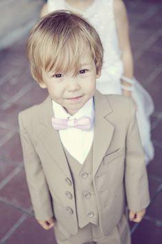Ring Bearer - #BowTie | See the wedding on SMP: http://www.stylemepretty.com/canada-weddings/ontario/toronto/2013/12/19/casa-loma-wedding/ Sarah Kate Photographer