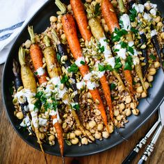 Roasted Carrots with Garlicky Farro, Chickpeas, Pepitas and Herbed Crème Fraîche