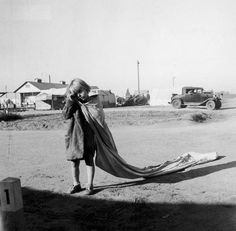 liquidnight:  Dorothea Lange -California, 1936 -A weary child from Oklahoma drags an empty sack into the cotton fields of California on her way to work at 7 AM. The girl is one of thousands ofOakieswho fled the drought, depression and dust storms afflicting their native state in the 1930s. [via Accidental Mysteries]