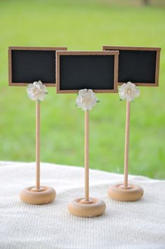 Vintage, rustic chic chalkboard table numbers, wedding signs - set of 15. $65.00, via Etsy.