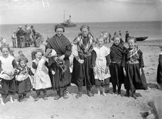 Aran Island Girls.The girls in this picture are wearing a variety of traditional Aran clothing: pampooties, crios belts and cross-over shawls. Pampooties are simple shoes made from a single piece of leather laced over the foot with thongs. A crios is a wide hand woven belt. The stitching on their home made clothes is clearly visible. 31 May 1939, National Library of Ireland